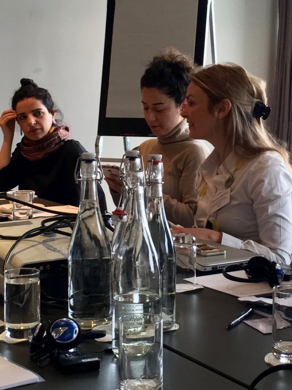 DPI Programmes Director Eleanor Johnson speaking with participants: Bejan Matur and Esra Elmas.