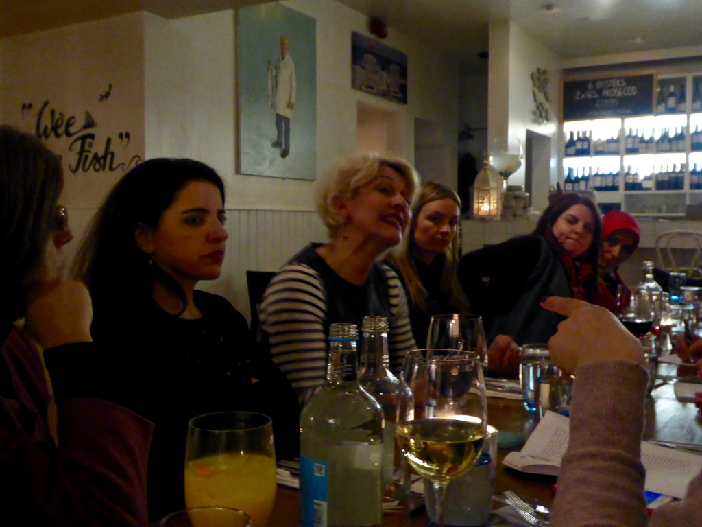 Ms Susan McEwan, Head of Programmes at Corrymeela, discusses reintegration of women with participants over dinner at Deanes Love Fish in Belfast.