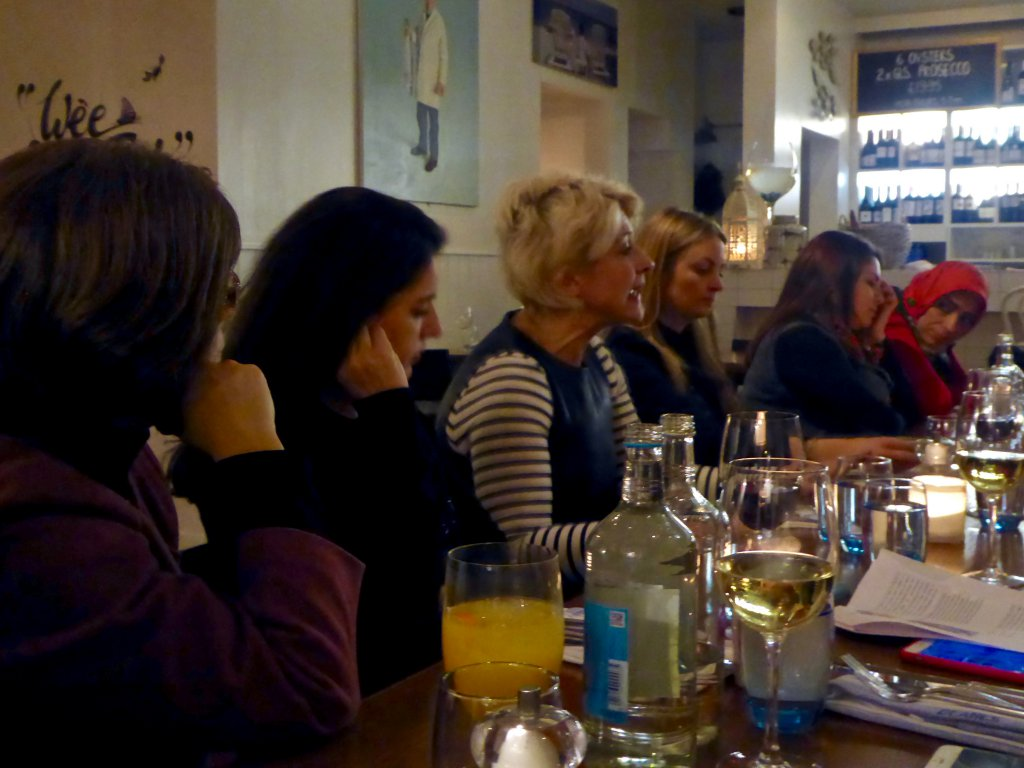 Ms Susan McEwan with participants during a dinner discussion at Deanes Love Fish in Belfast.