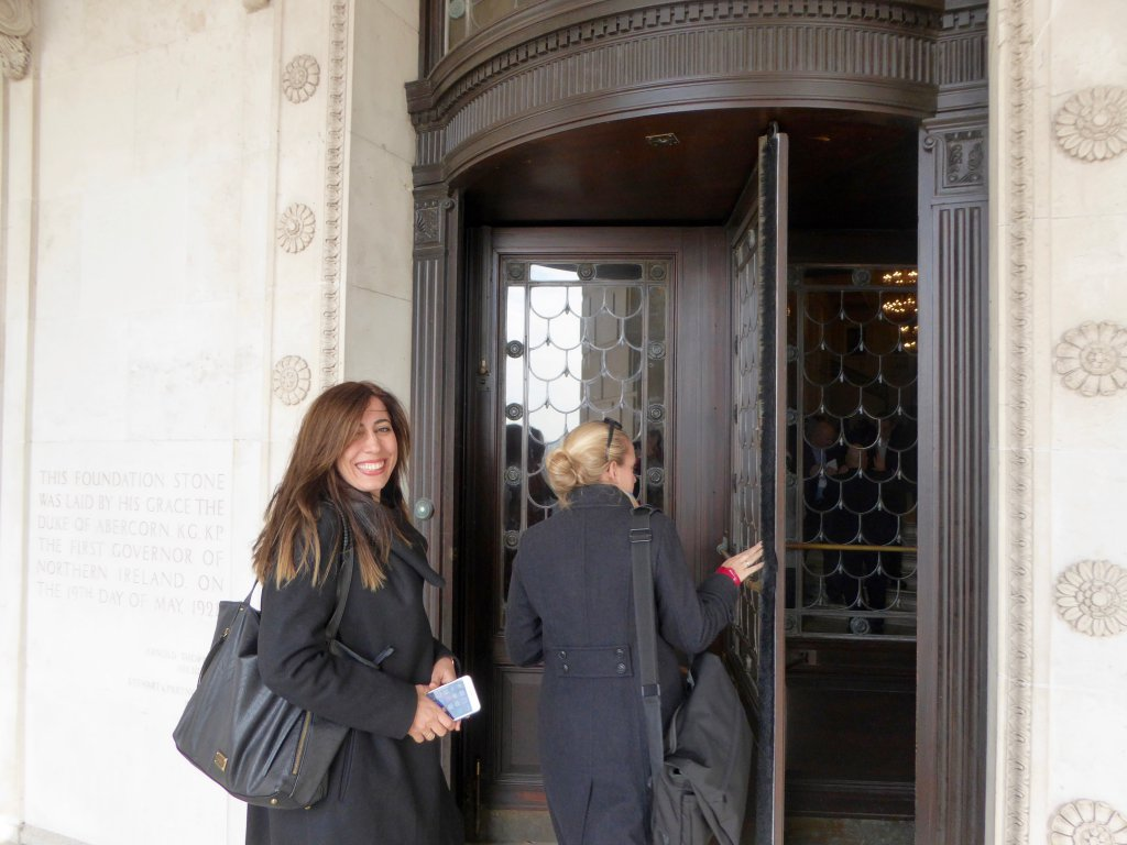 DPI participants, Ms Nurcan Baysal and Ms Sacha Moreira, Development and Funding Manager for DPI enter the Stormont House in Belfast.