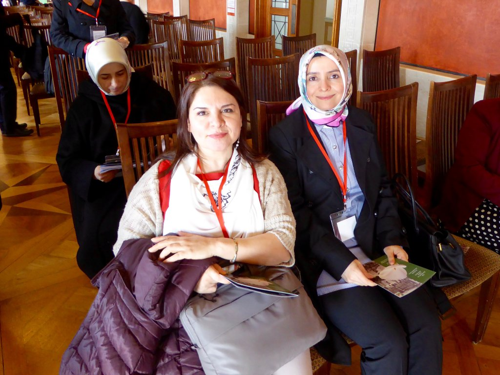 Ms Fadime Özkan and Ms Ayşe Koytak wait for the Easter Rising Commemoration to begin at the Stormont House in Belfast.