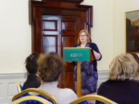 Ms Sarah McGrath of the Irish Department of Foreign Affairs speaks with participants about Ireland's role in the Good Friday Agreement at the Iveagh House in Dublin.