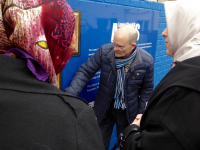Tour Guide, Mr Noel Large, explains a mural during a tour of the Shankhill Road area in Belfast.