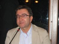 Deputy Governor Mehmet Yüzer giving a speech during dinner hosted by Van governor Aydın Nezih Doğan