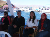DPI Director Kerim Yildiz, Asli Tunç, Nazvan Mizrak and Fatma Bostan Ünsal on a boat to Akdamar Island
